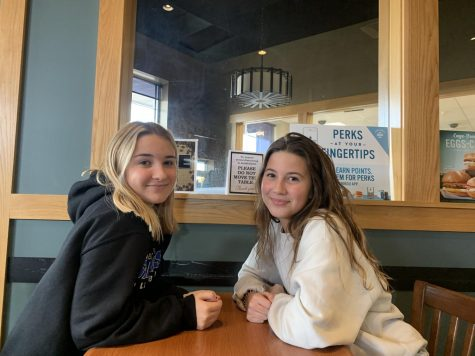Emma and Grace, sisters enjoying coffee together at Caribou.