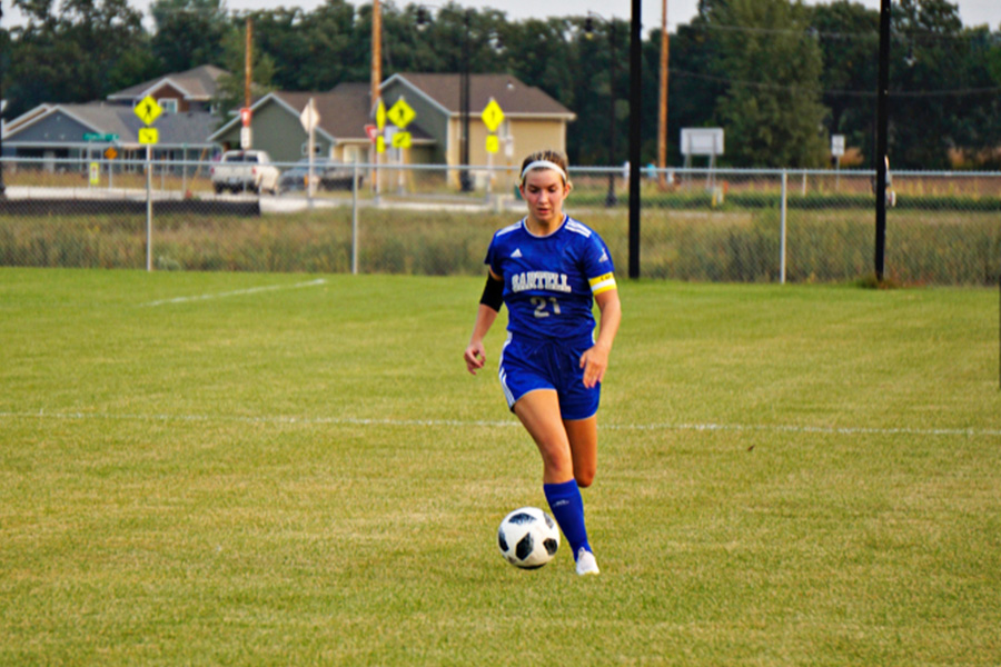 Madi Kruse dribbling the ball up the side of the field at the regular season game against Sauk Rapids.