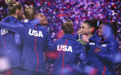 The women's USA national gymnastics teams celebrates prior to olympics.