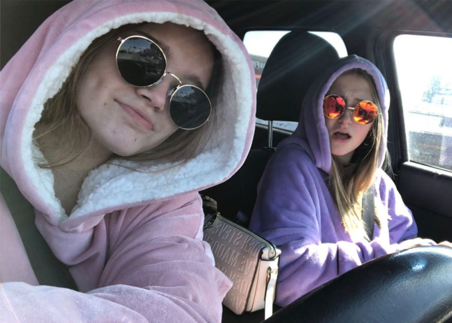 Senior Grace Elness and junior Jules Reed enjoy staying warm in their Comfy while driving to enjoy a hot Starbucks.