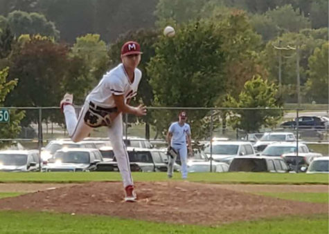 Carter Kent pitching for his baseball team.