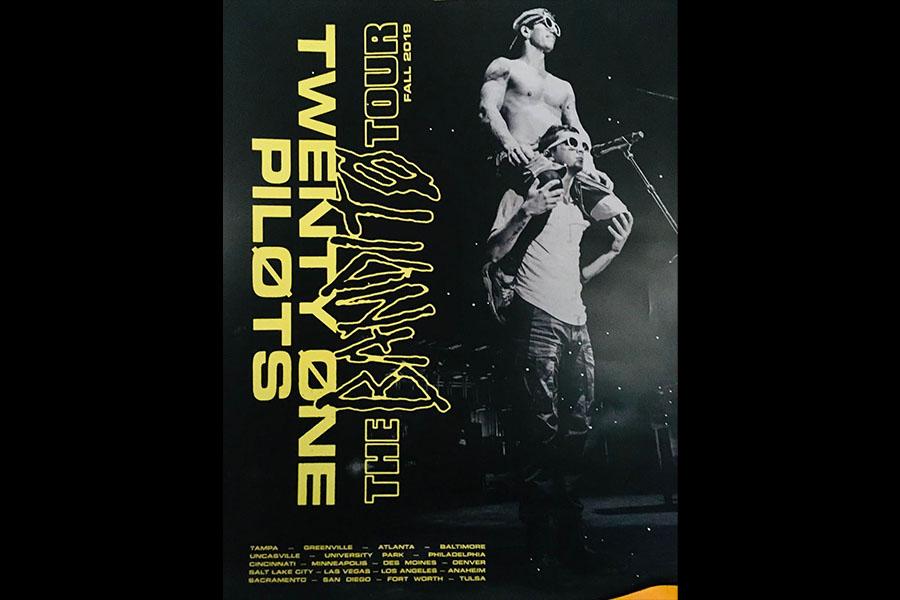 Drummer Josh Dun sitting on singer Tyler Josephs shoulders at the end of a concert poster.