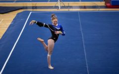 Marly Michaud performing her floor routine at the state gymnastics meet.