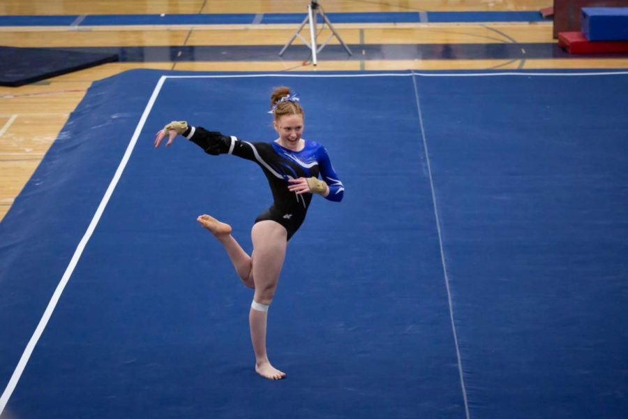 Marley Michaud performing her floor routine at the state gymnastics meet.