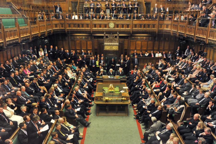 The House of Commons holds an active session in London.