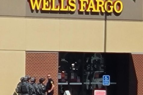 Swat waiting at the door of the Wells Fargo to confront the suspect.