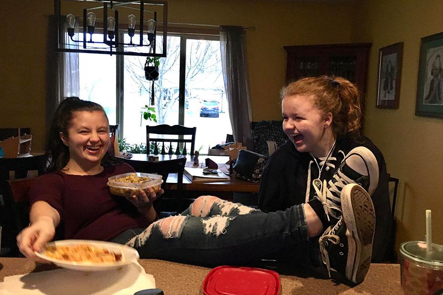 Sisters Olivia (Saretll senior) and Isabel Binsfeld (Sartell 7th grader) laughing at an inside joke.