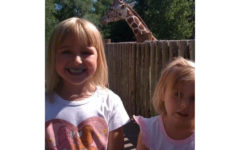 Grace and Lily enjoying a day at the zoo in there younger days.